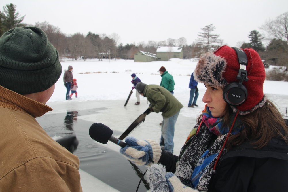 Holtzman conducting an interview at an ice harvesting demonstration at the White Memorial Conservation Center in Litchfield, Conn.