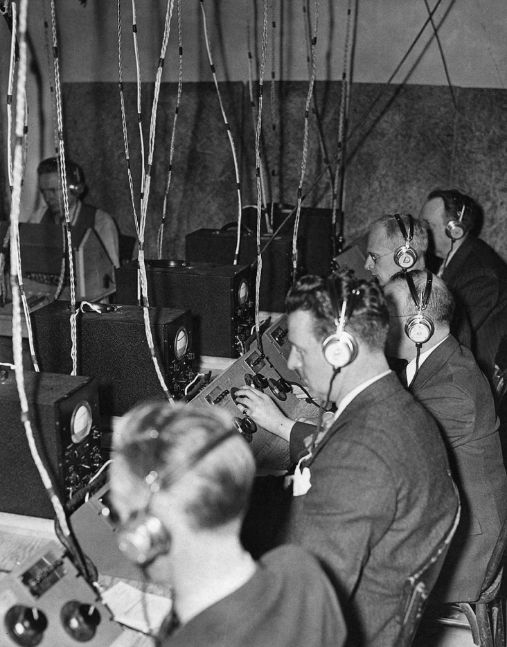 Sound technicians in 1941 listen through earphones to the music ofFantasiapiped in from the orchestra stage on the floor above.