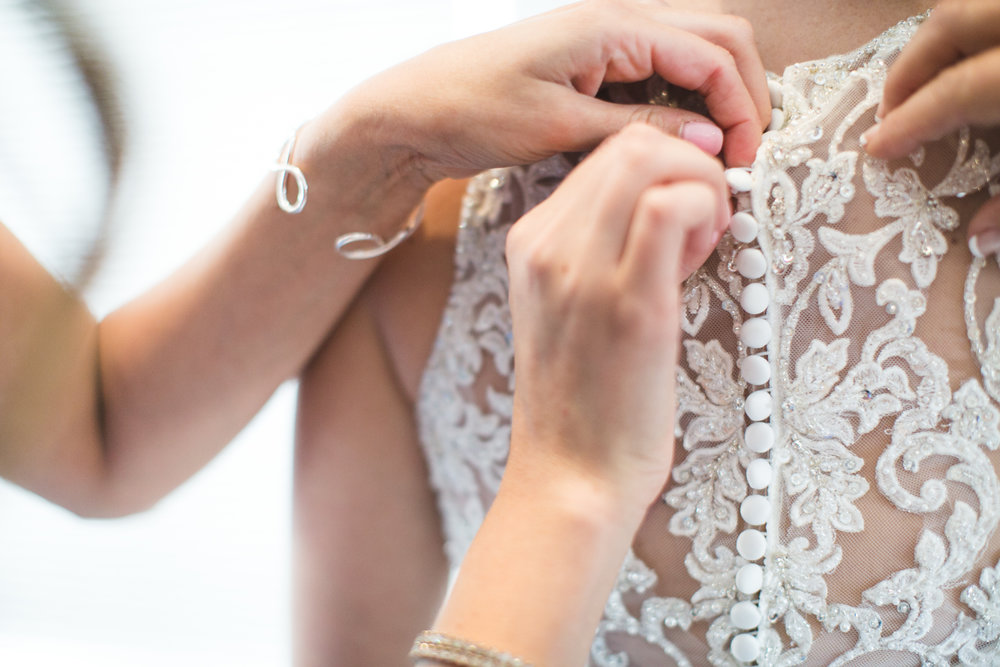 I love it when a wedding dress has so many buttons.  It slows down the moment so that I can capture plenty of photos!  More buttons; More moments!
