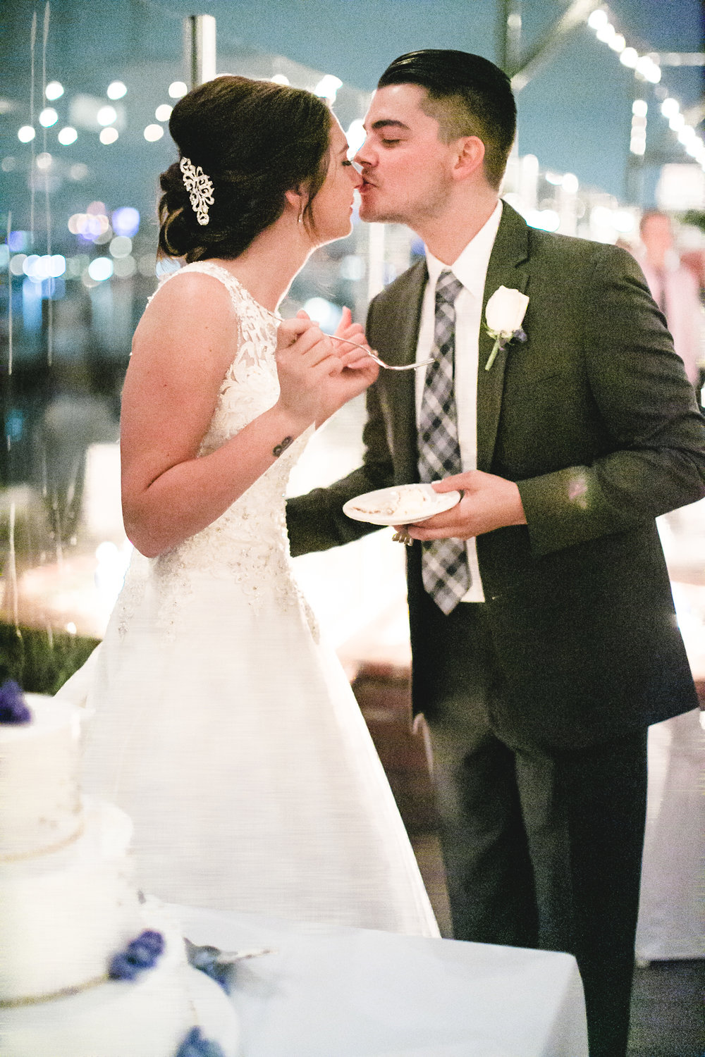 This was an adorable moment.  Aaron got just a bit of cake on her nose and kissed it all off :)