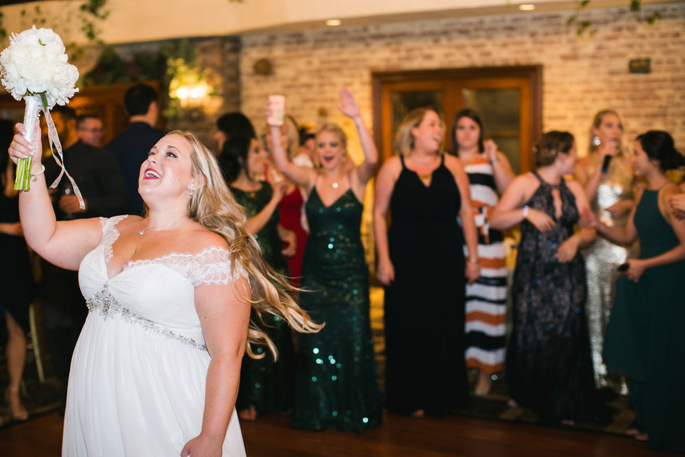 A surprise at the catch of this bouquet toss!