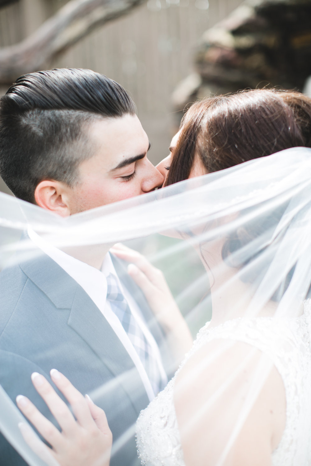This year, I really loved playing with veil details in photos. It wasn't easy and it took me at least 10 shots to find this perfect one but it was absolutely worth it. Also, Stephanie + Aaron were one of my first couples this year and they really couldn't have started it off any better for me.
