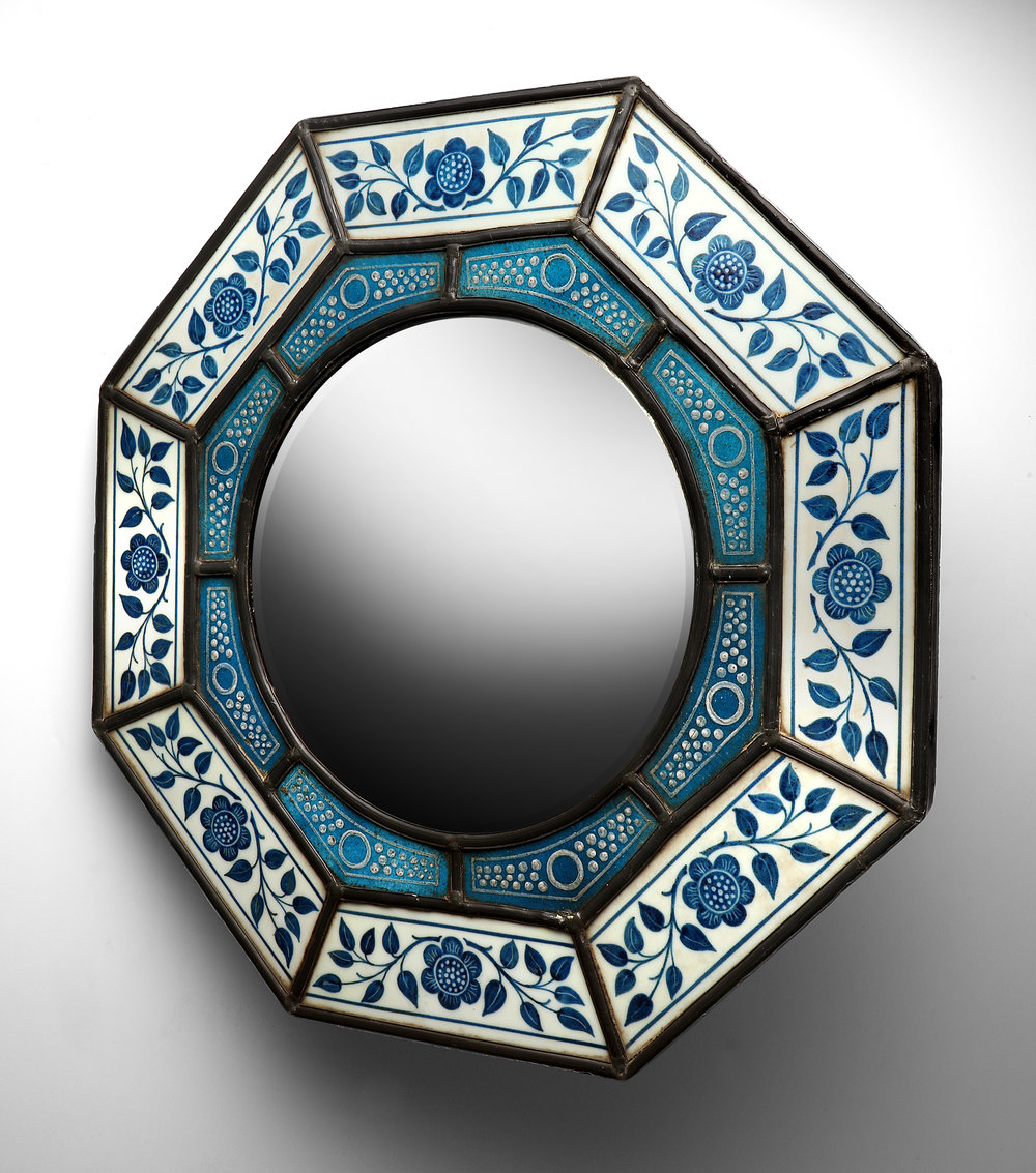 James Powell & Sons (Whitefriars) Aesthetic Period octagonal mirror. Convex plate and leadwork. Opaline glass surround with enamelling. Polka dot design on opus sectile inner frame. Around 1870.  Sold.
