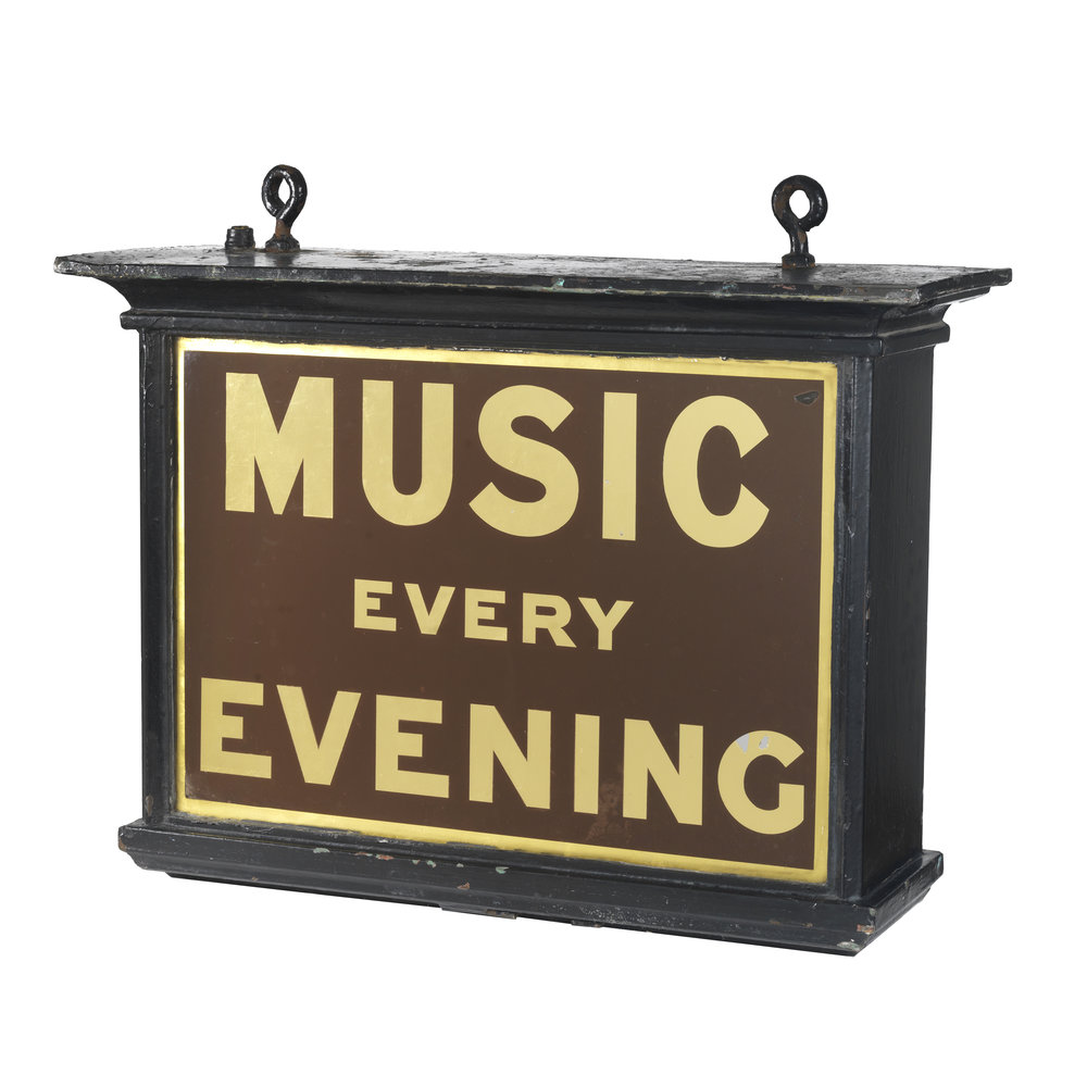 Late Victorian music hall hanging sign. Painted galvanised metal frame with glass handpainted verre églomisé signage.  H63cm W74cm D27cm  SOLD.