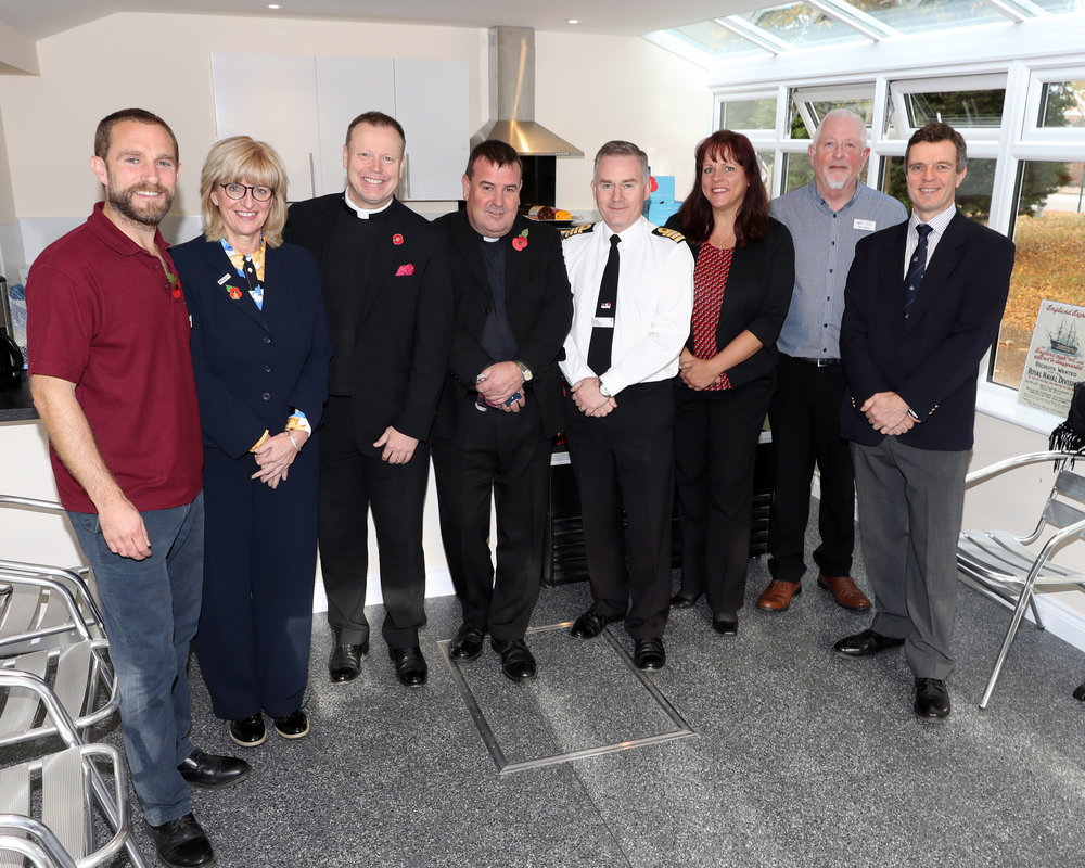 Chaplain of the Fleet, The Venerable Ian Wheatley with Captain Peter Towell, the Commanding Officer of HMS Sultan,  Aggie's Pastoral Workers, CEO of Aggie's, Craig Fulton and representatives from the RNRMC at the opening of the new Galley and Coffee Bar.