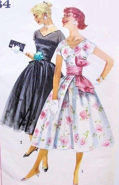 obi sash with big knot 1950s pink party dress.jpg