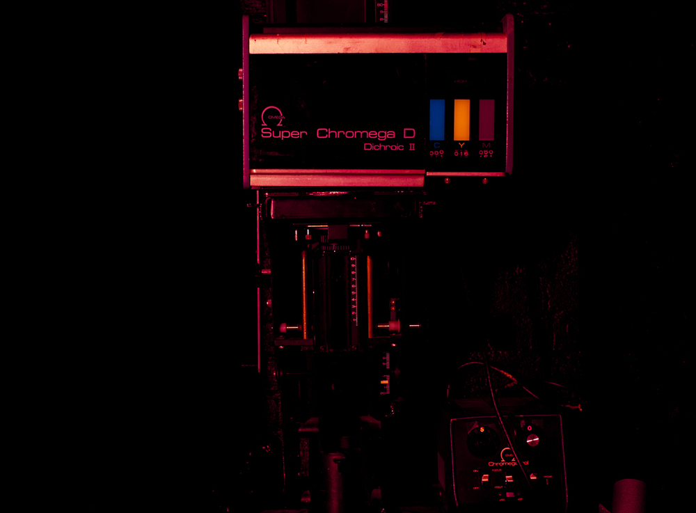 ABOVE: The Omega Super Chromega D color enlarger.  Located at the Gowanus Darkroom. A true workhorse enlarger, the dichronic head allows for color filtration for correcting color casts for printing color, as well as adjusting contrast for variable contrast (VC) black & white papers.  These darkroom staples are built to last a long time, with easily accessible parts for replacement and repair.  Given that working enlargers are often found over 20 years old, the quality of build and materials is top-notch, and the accompanying digital timers are reliable and easy to use.