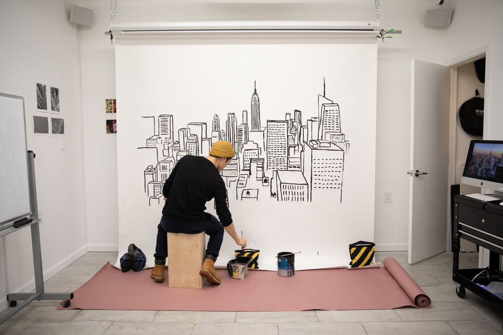 Pre-pro BTS! Justin hand-painting NYC skyscrapers on our seamless to create a festive cityscapes backdrop.