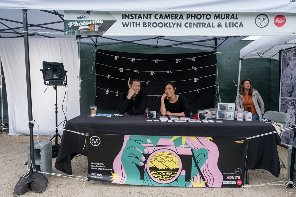Justin Lin  and  Lanna Apisukh  holding down the BKC tent activity with  Leica & Adultr  at  Photoville .