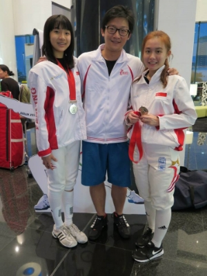 Coach David with Lau Ywen and Joyce Ng after winning the team Silver
