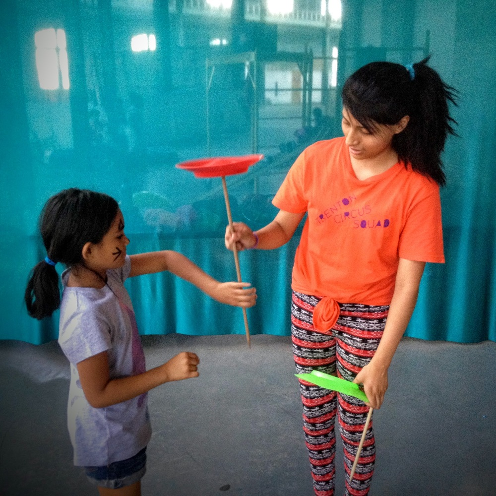 Teaching plate spinning at a skills workshop