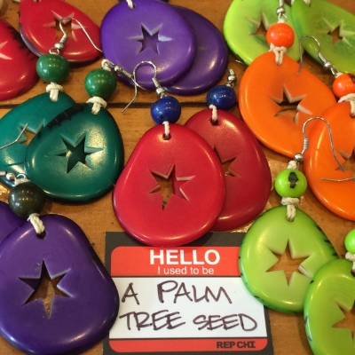 Colorfully dyed using natural pigments tahua seed (a type of Palm Tree) earrings featuring a hand carved Chicago Star cutout.