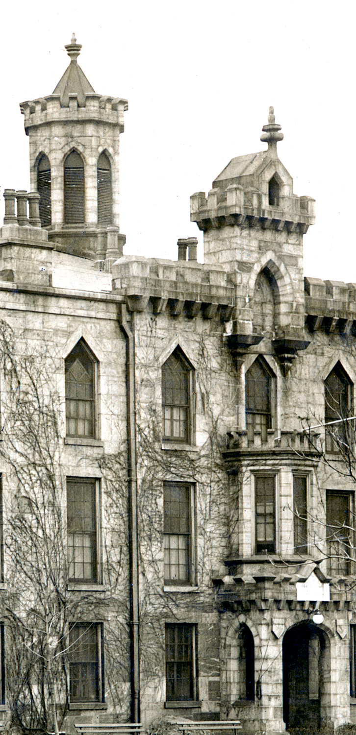 Original architectural details included a tower with recessed arches, a cupola at the main entry, and crenelated parapets throughout, New York City Municipal Archives
