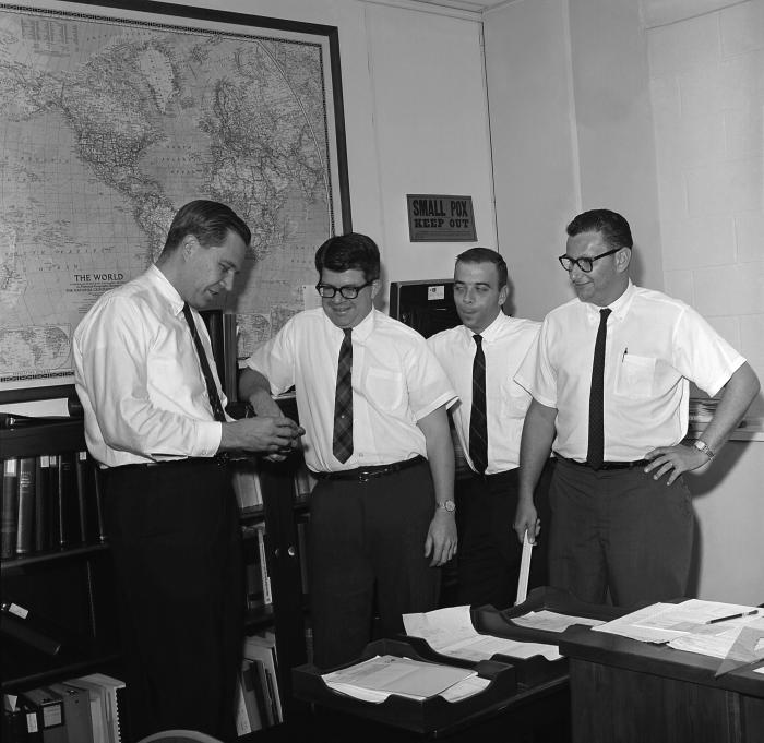 Standing left to right, Dr. Donald A. Henderson, Dr. J. Donald Millar, Dr. John J. Witte, and Dr. Leo Morris in one of the Centers for Disease Control and Prevention's (CDC) former offices. Dr. Donald A. Henderson, headed the international effort during the 1960s to eradicate smallpox. CDC