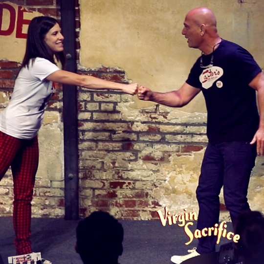 Nicole Blaine greets Howie Mandel in Virgin Sacrifice's June show, a surprise guest. You never know who will show up on the Virgin Sacrifice stage.