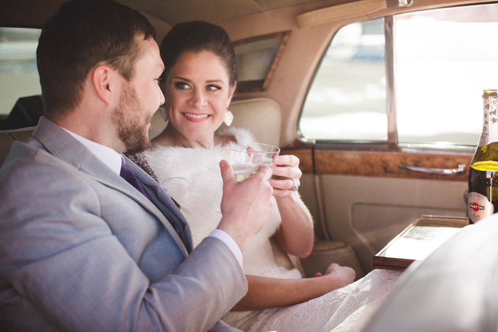"""After they said """"I do,"""" Shana and Nathan stole away in a classic Rolls Royce for a glass of champagne."""