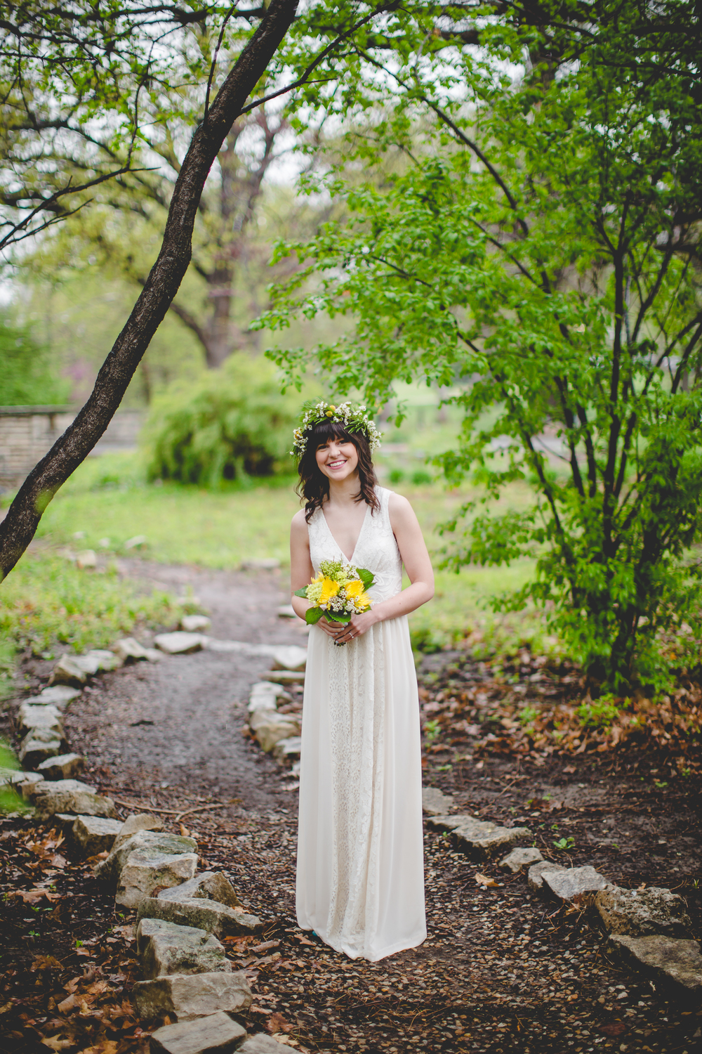 This wedding was in Kansas in April so there was a pretty good chance it would rain. And rain it did. The vibrancy of the Spring day worked so well with the bright colors.