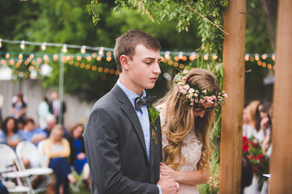 Can you believe a family friend put together all of the floral arrangements for this backyard wedding?