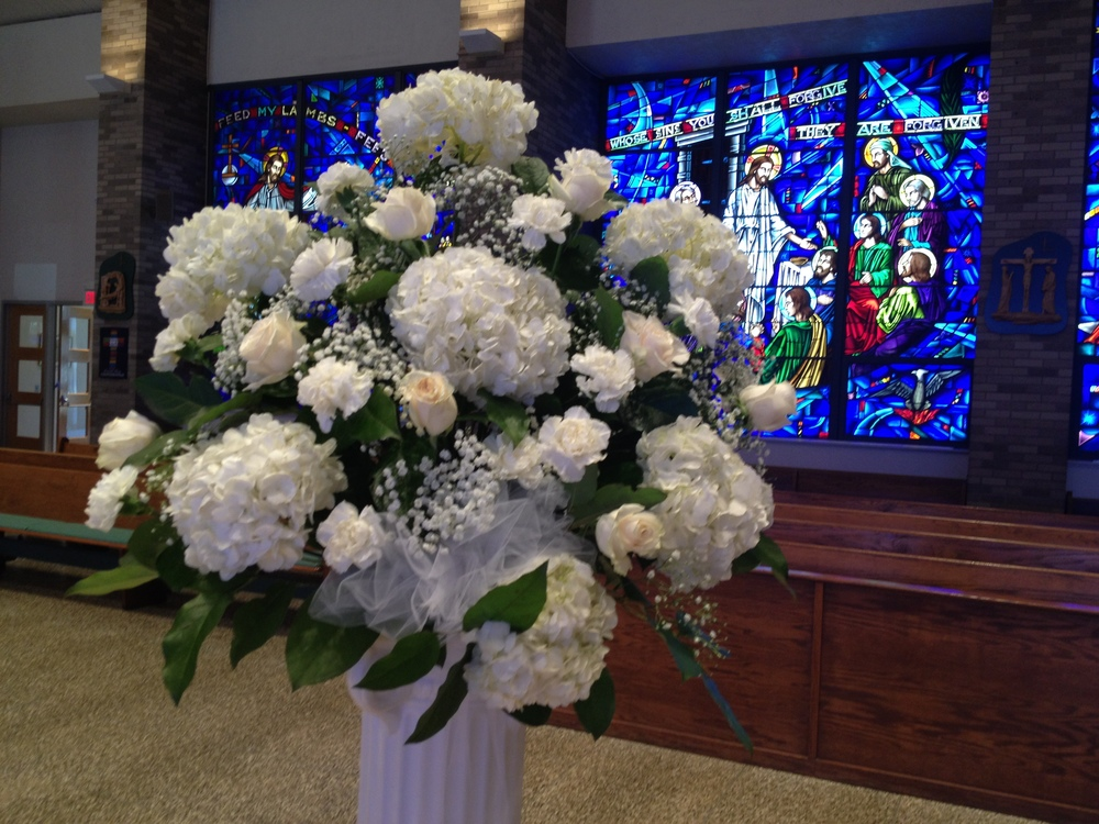 Altar Arrangement against the beautiful Stained Glass Murals at Our Lady Of Mercy RC Church in Park Ridge, NJ