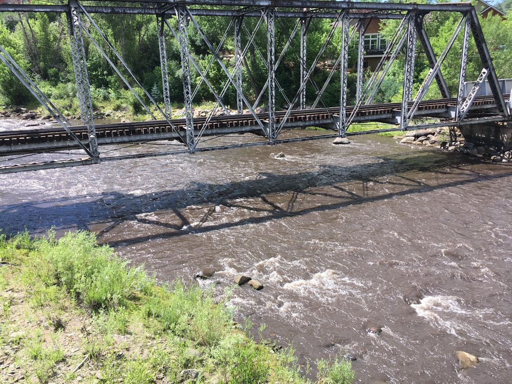 The Animas at Rotary Park appeared light black with ash on Monday, June 18th.