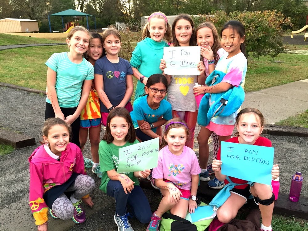 This was part of the workout portion of practice the day we planned their Community Impact Project. The girls each chose a person or cause to run in honor of. About half of the team ran for their friend and classmate Isabelle who has been diagnosed with cancer again for the third or fourth time.