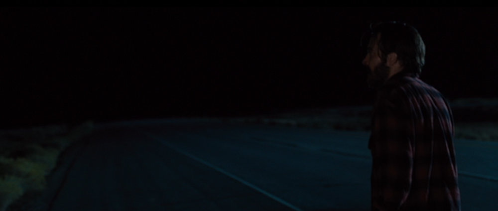Nocturnal Animals - The road goes on forever in cool moonlight.