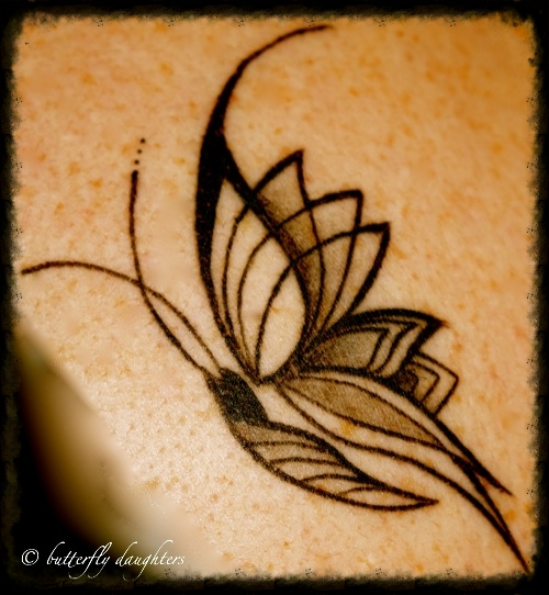 Butterfly on shoulder blade