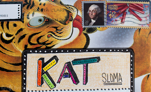Mail art with the tiger licking the stamp