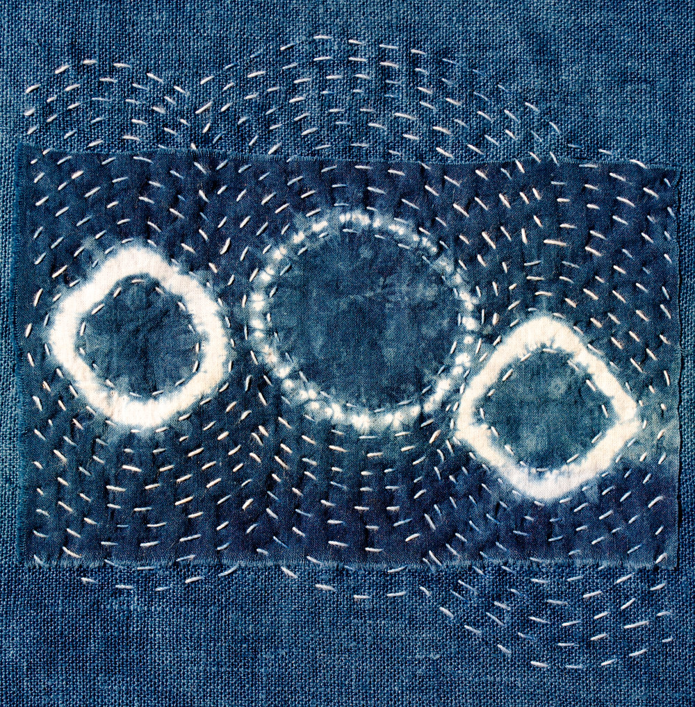 Detail of a Shibori Dyed Indigo Embroidered Pillow