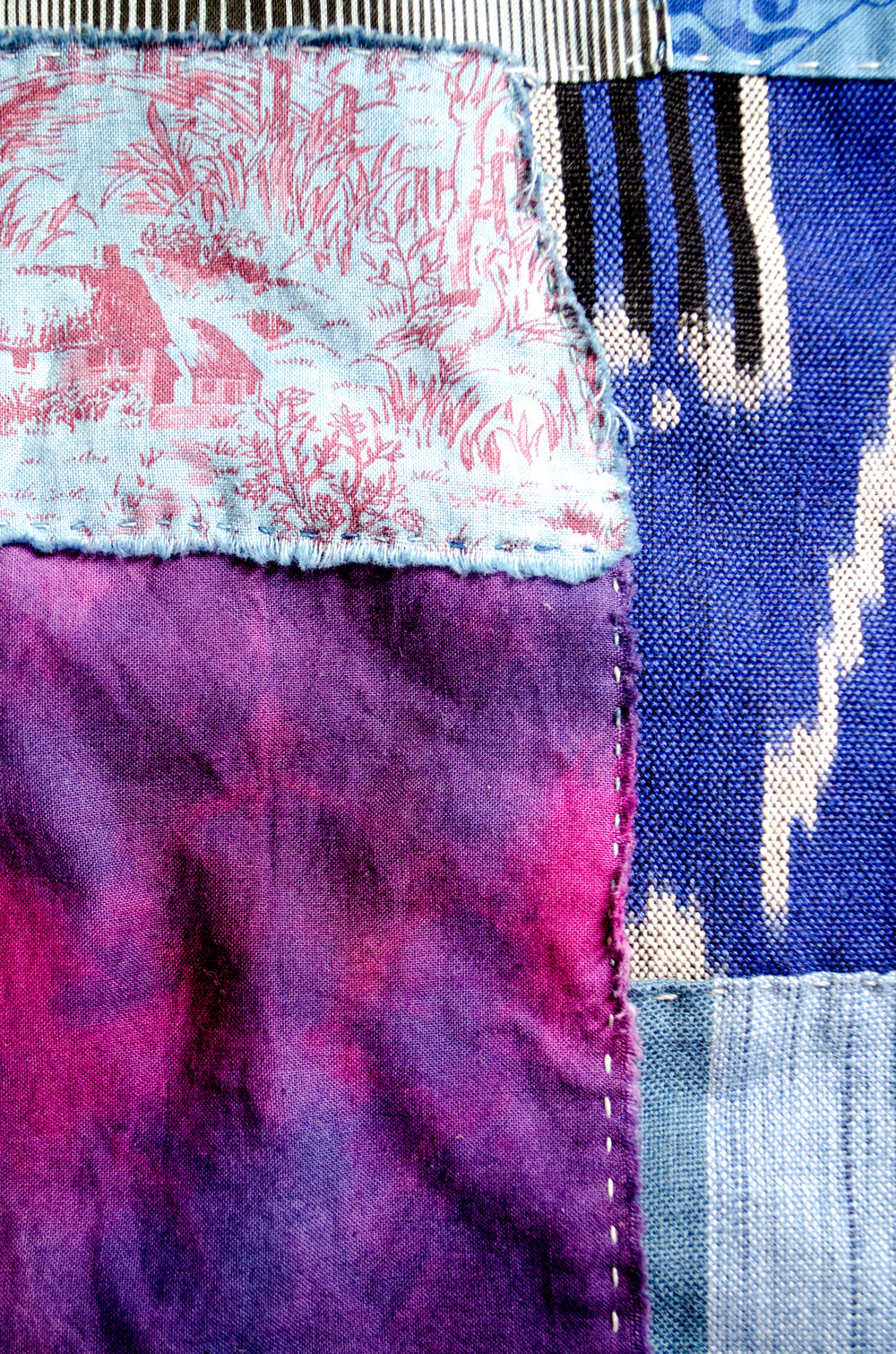 Boro inspired stitching using hand dyed scraps of cloth overdyed in the indigo vat by Carlyn Clark