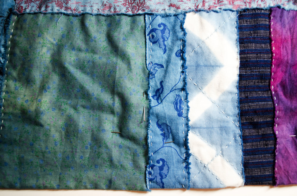 scraps of cotton, dipped in the indigo vat to overdye and then stitched together in the boro manner