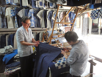 Buying handwoven cotton stripe in Zhujiajiao, China
