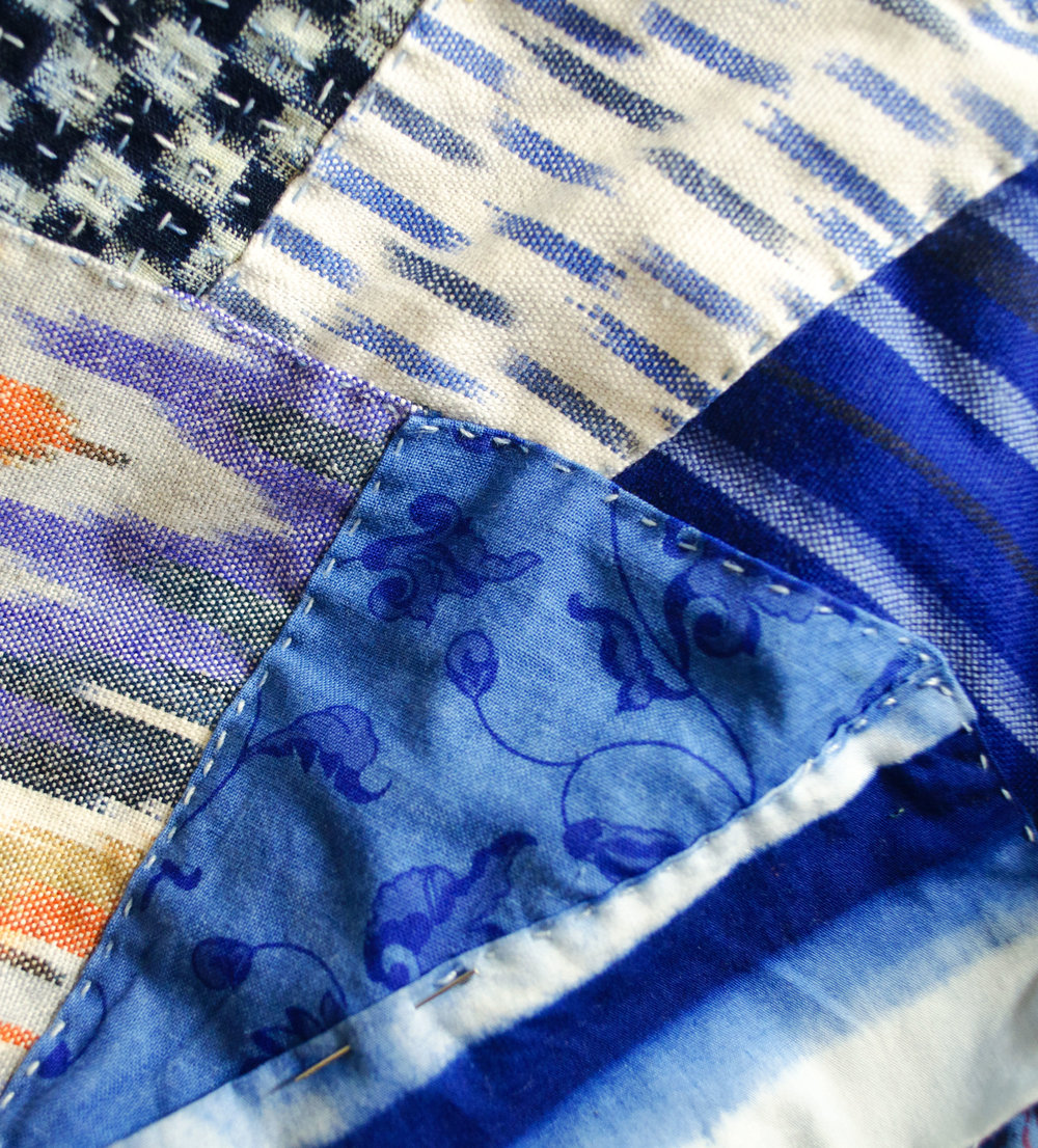 Shibori dyed cotton, overdyed indigo prints, ikat and woven stripes patched in the boro style