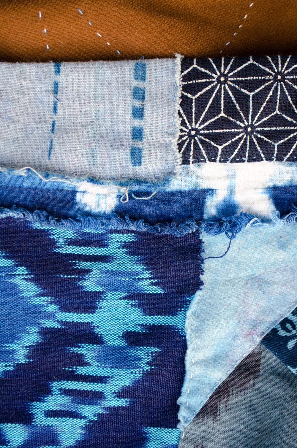 Boro stitched ikat, shibori and indigo dyed scraps by Carlyn Clark