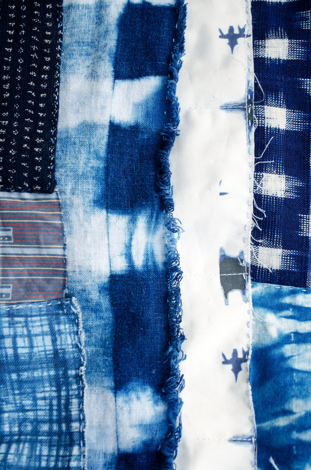 Shibori dyed linen stitched with other patches
