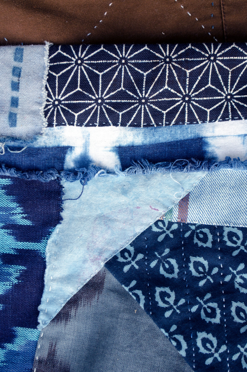 Indigo dyed cottons patched in the boro style