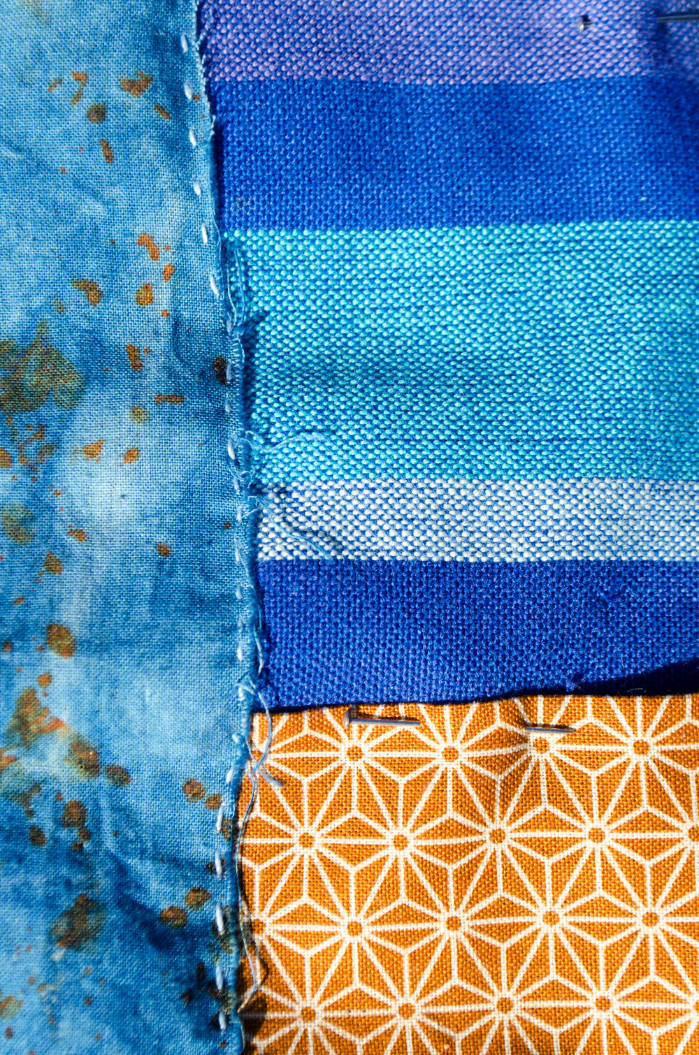 Rust-dyed cotton stitched to a Japanese print