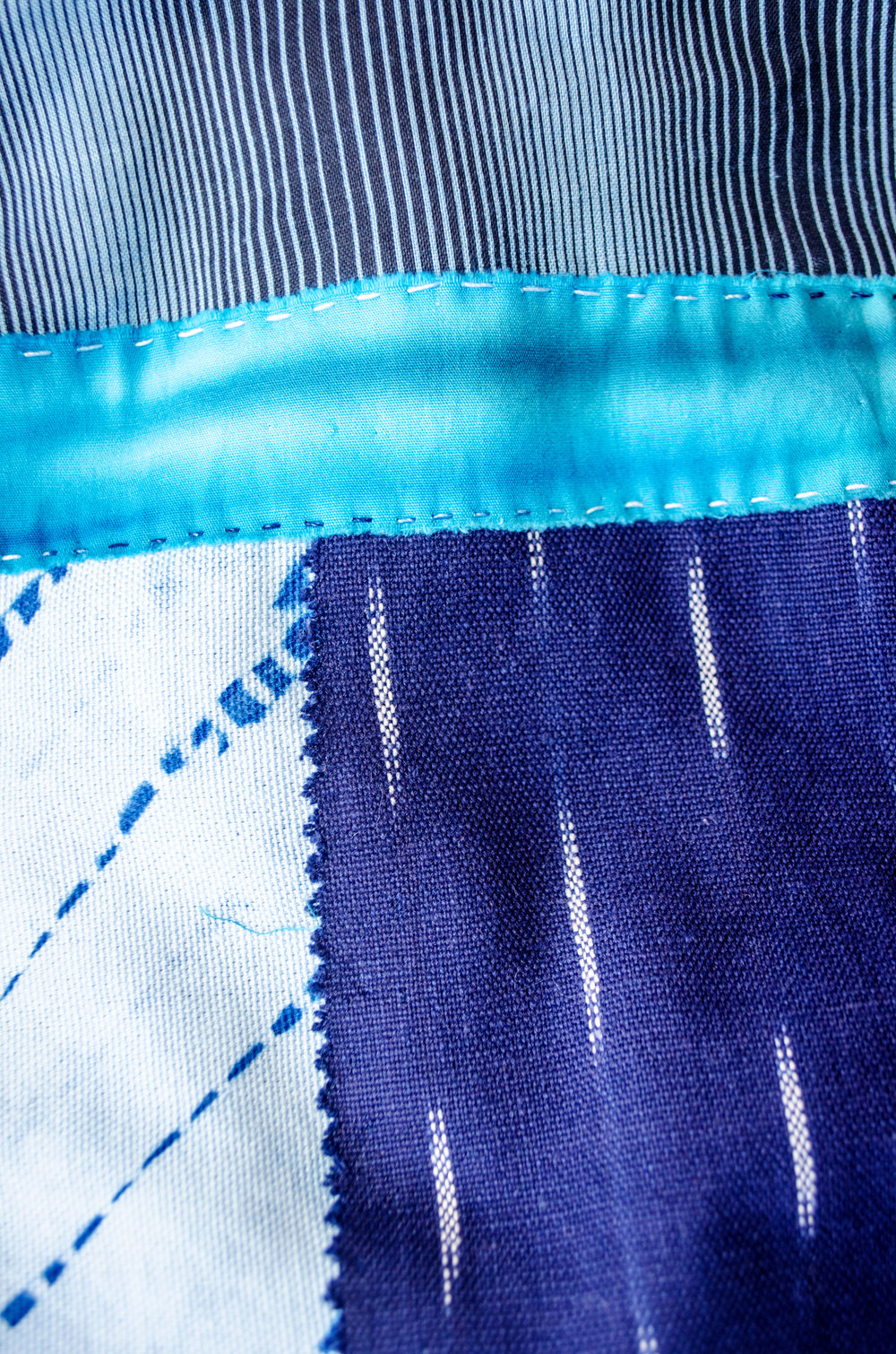 Shibori and ikat dyed with indigo