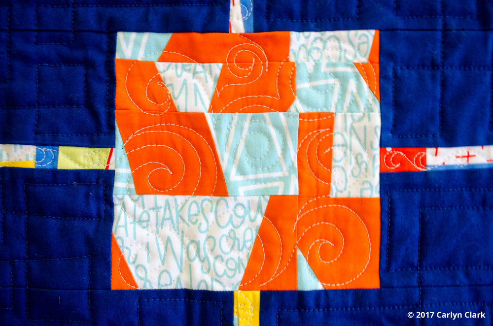 Improvised piecing in orange and turquoise