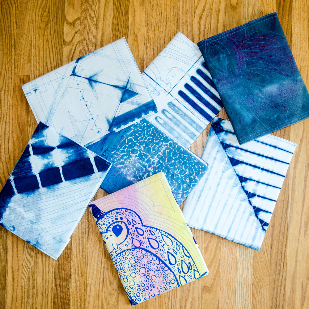 use hand dyed and printed fat quarters to cover inexpensive composition books for boho styled journals
