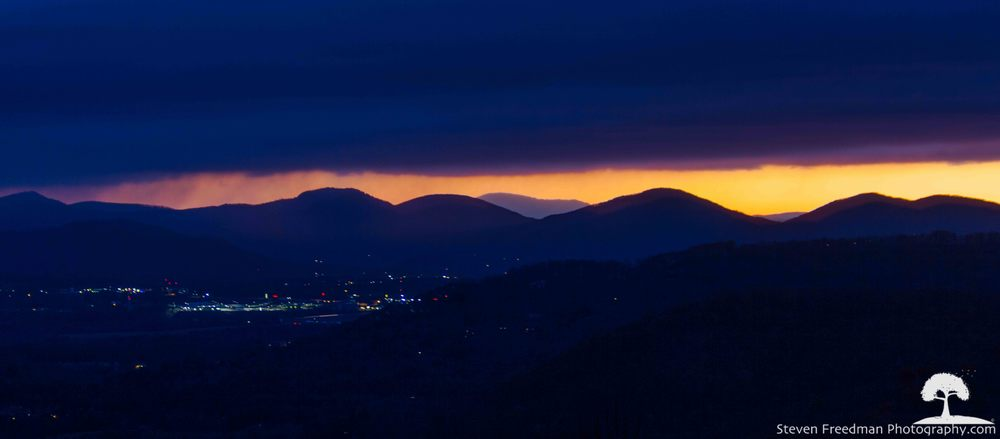 Day Break around 6:15 am with a view of the Lowe's shopping center on Airport Road south of Asheville.