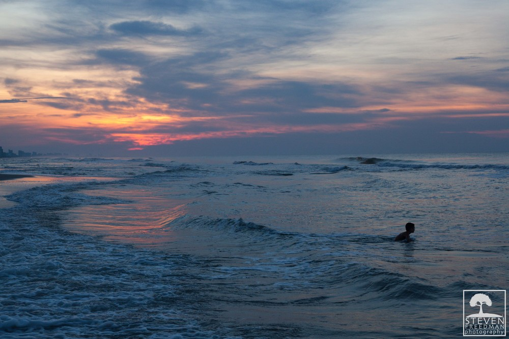 A boy enjoying the Atlantic for a dawn dip
