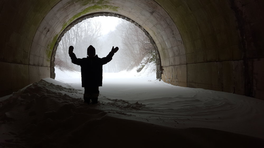 This is a picture of my six year old son on a snow drift inside the Grassy Knob Tunnel.  I had never seen snow drifts this high before.
