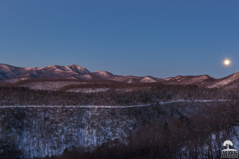 The Wolf Moon.  The snow covered road in the middle of the frame is Wash Creek Road or Fire Road 5000 and leads down to the North Mill's River Recreation Area.