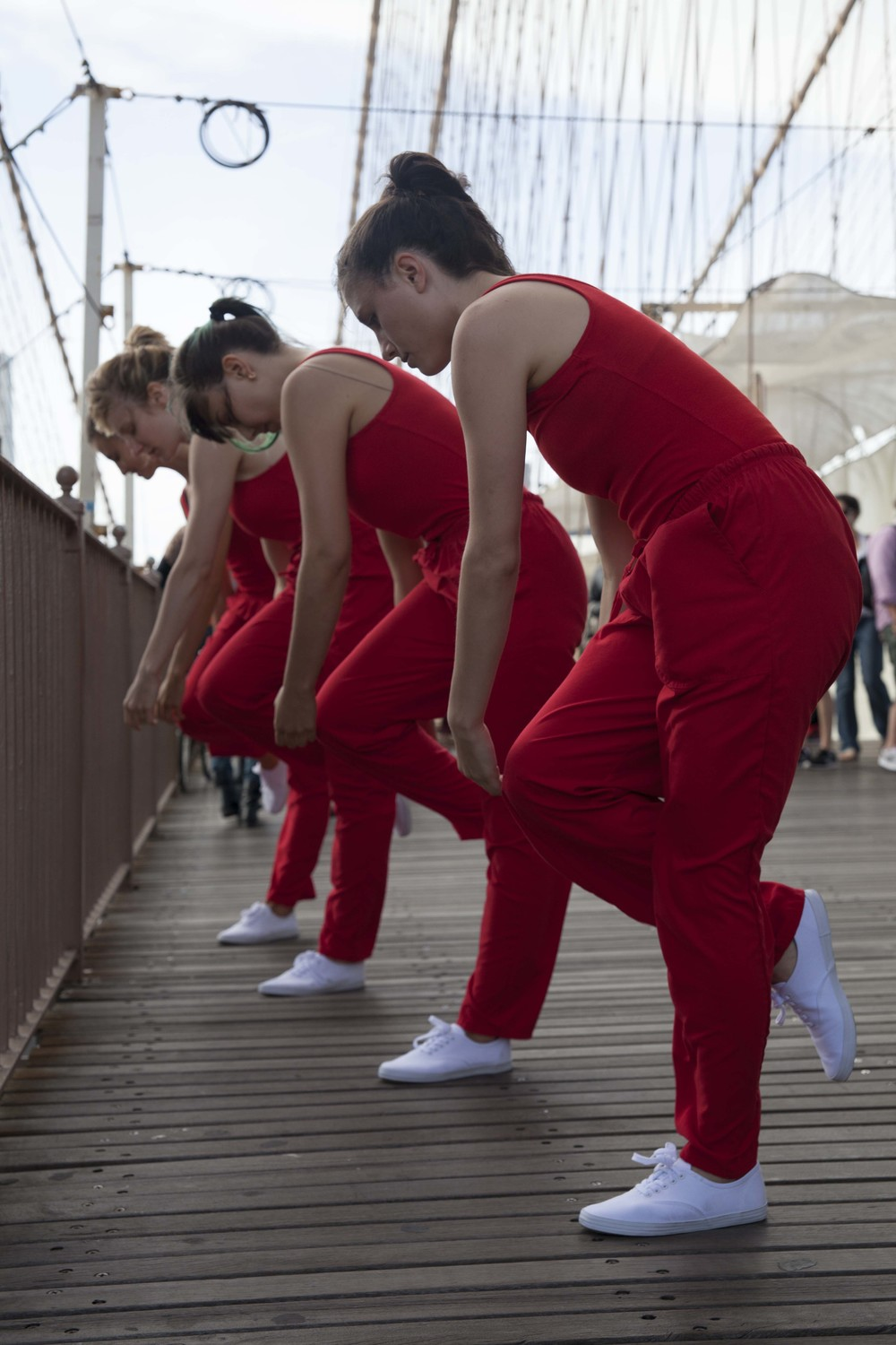 "While crossing the Brooklyn Bridge, Rick Moody encountered dancers Kristin Swiat, Giovanna Gamna, Lydia Chrisman, Maya Orchin, Jessica Myers, and Annie Saeugling performing choreography by Jen Harmon for ""When I Left the House it was Still Dark"" in New York City in 2013. Photograph by Ayden L.M. Grout"