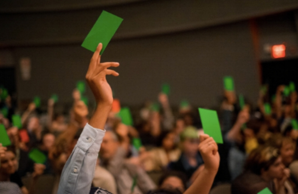 Audience members voting on a policy proposal at the 2015 Legislative Theatre Festival. Credit Will O'Hare.
