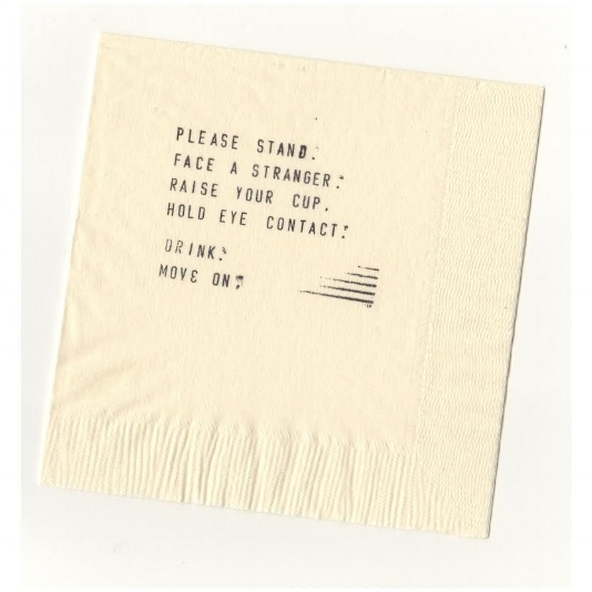 Hand-stamped cocktail napkin from  Linger Longer Toast , a participatory public performance that took place in 2014. Credit Chlo ë  Bass.