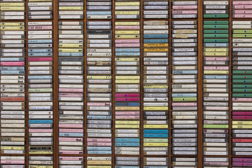 Mark A. Rodriguez,  2nd Gen , 2010-2017, detail; CNC-routed mahogany and enamel shelving units; audiocassettes; ink and marker on cassette sleeves; plastic cases; 92.2 × 122 × 3 ½ inches (234.19 × 309.88 × 8.89 cm)
