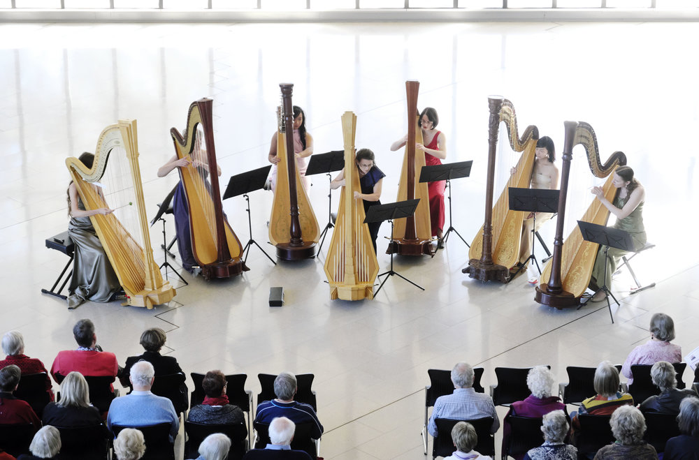 Alice Giles, centre, with the Seven Harp Ensemble at the Canberra International Music Festival. Picture: Peter Hislop.