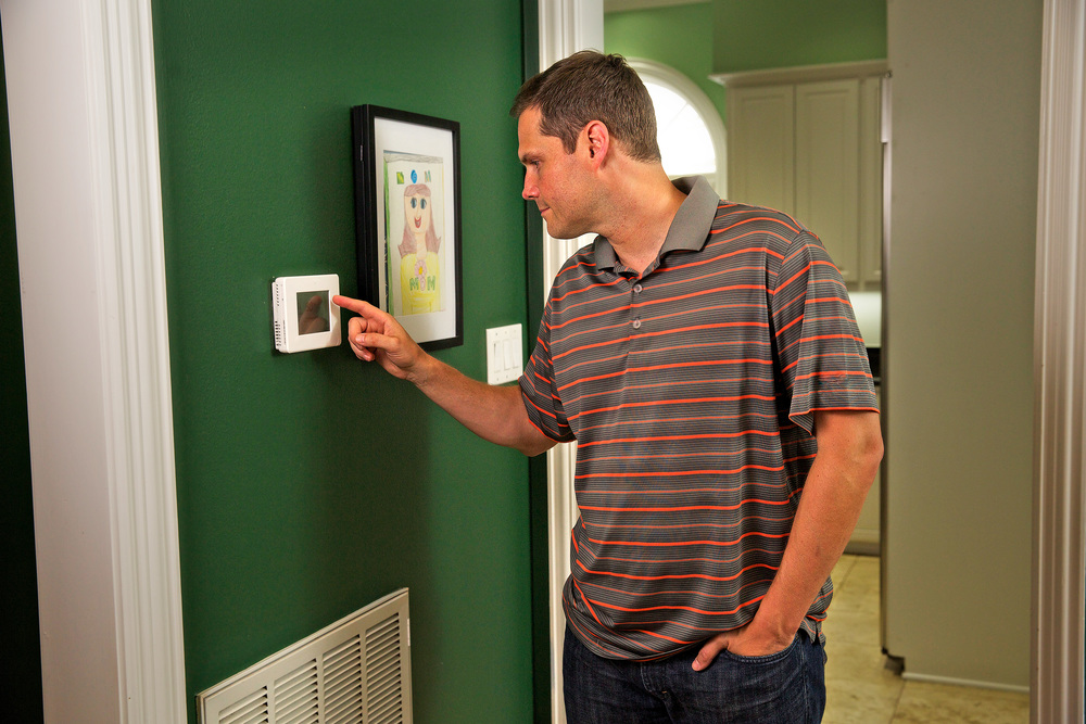 20 - Dad Changing Thermostat.jpg